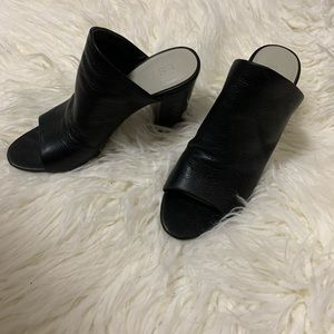 1. State black pebbled leather mules